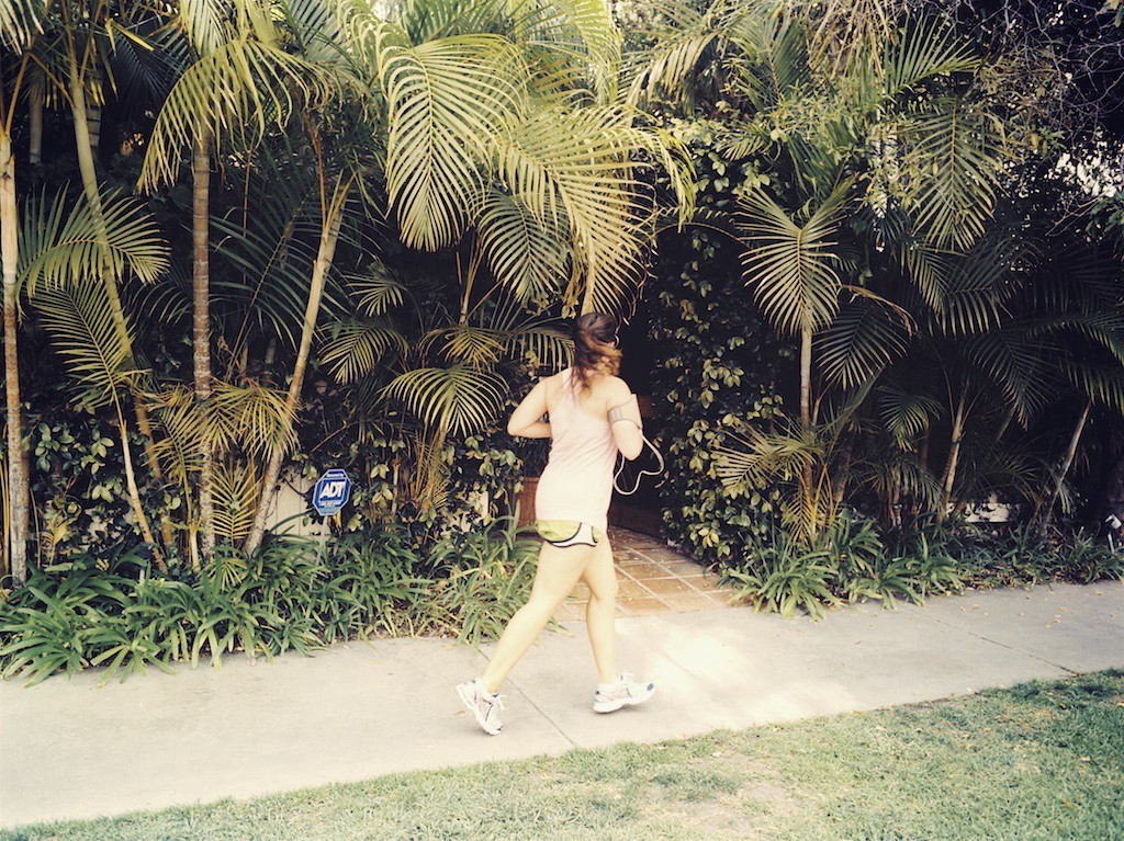 A jogger runs by the entrance to Nicole Brown Simpson's condo, where she and Ron Goldman were murdered in 1994. Photos by CarlosNuñez