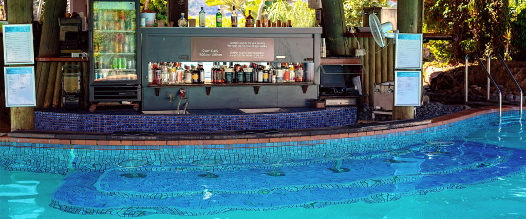 A Wet and Wild Cultural History of the Swim-Up Pool Bar