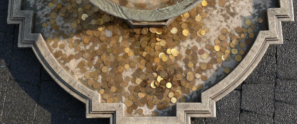The Watertight Economics of a Coin-Throwing Fountain